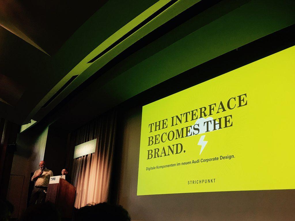 """Vortrag bei dem auf der Folie """"The interface becomes the Brand"""" steht"""